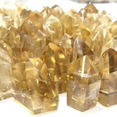 Polished Natural Citrine Towers  Citrine warms, cleanses, and energizes. The stone of success, Citrine attracts abundance and promotes wealth. You can use Citrine to attract wealth by placing it in the far left corner of one's home, or in a cash box or drawer. Citrine is also very protective of the environment and is known for grounding negative energy.