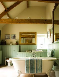 The Wow factor: converted cider barn now offers unique vaulted bathroom with superb ensuite dressing room!  Photography by Christina Dithmar