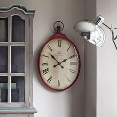 Graham and Green's Red Oval Clock. I really love this oval shape! Makes it more unique!!
