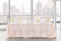 Seeing this citrus wedding inspo on a Columbus rooftop made our hearts pitter patter in the way only a modern romantic mood can. Freeform floral pillars, lucite chairs, ikebana arrangements, a bas relief cake - the only thing more breathtaking than these delicate details is the Galia Lahav gown with intricate embroidery from off-the-shoulder sleeves to sweeping train. Need we say more? Forest Wedding Reception, Tent Reception, Rooftop Wedding, Luxe Wedding, Ballroom Wedding, Wedding Tables, Wedding Reception Decorations, Wedding Vendors, Modern Floral Arrangements