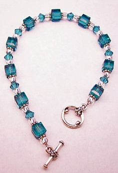 cube-shaped and bicone-shaped crystals in a fabulous shade of TEAL!  Bali silver spacers and silver-lined glass beads serve as lovely accents