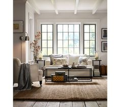 Love the textural combo and monochromatic color scheme. Looks like a super cozy room. Burke Coffee Table | Pottery Barn
