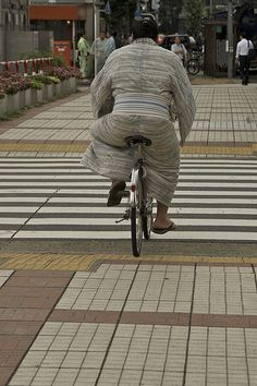 Sumo wrestler riding a bicycle, Tokyo, Japan