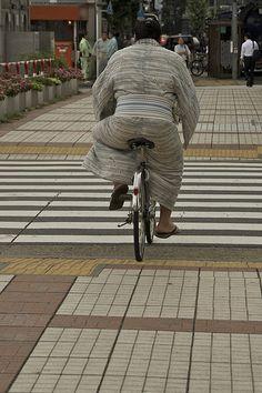 Sumo wrestler riding a bicycle, Tokyo, Japan