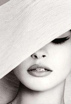 Brigitte Bardot - shaded by a hat