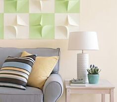 Two dimensional tiles in the wall create a piece of artwork that can also be changed when you want.