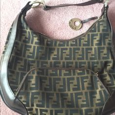 Authentic Fendi set REDUCED** Authentic purse and wallet set. Great deal! Hardware has a little wear but both have a lot of life left to them! FENDI Bags