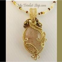 Rose quartz gemstone | Mother Nature inspiration: Wild overgrown plant vines cascading down the gemstone | Czech fire beads | One-of-a-kind | 6 metres wire |  8 creation hours | MTS stamp | Quality imported fused gold wires from US | Dimension 6cm x 3cm.  Handmade Korean glass beaded necklace (...