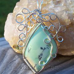 """This stunning light green Variscite cabochon is wrapped in Sterling Silver wire.  It is  approximately 1 3/4"""" at its widest by 1 3/5"""" tall and will come on an 18"""" black  leather cord.  A must have for every discerning jewelry wearer!"""