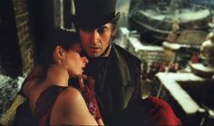 Les Mis (2012) | Movie Still: Anne Hathaway (Fantine) and Hugh Jackman (Valjean) in Les Miserables.