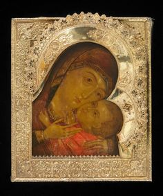 Icon painted in egg tempera on wood prepared with cloth and gesso; silver oklad. Subject: the Korsun Mother of God. The oklad is embossed with symmetrical foliate ornament.