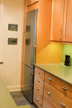 I like the idea of a fridge surround cabinet. It finished the counter and the backsplash and just looks higher end without adding a lot. Not sure what I would put in the cabinet above the fridge. Maybe wine/liquor storage?  fridge surround cabinets - Google Search