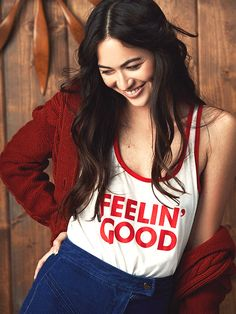 Good times are here to stay in the Feelin' Good Racerback Tank. - Racerback tank top with contrast color binding trim. - Printed on the front with our Feelin' Good graphic. - Vintage White / Red - S, Autumn Cozy, Getting Cozy, Staycation, Racerback Tank Top, Boss Lady, Autumn Winter Fashion, Vintage Inspired, Vintage Fashion, Model