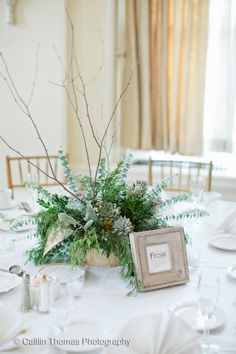 HEPATICA wedding florals (wintery greens with eucalyptus, juniper, cedar, brunnia, dusty miller, succulents, and birch branch) – photo: Caitlin Thomas Photography