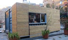 Residential.  MEKA Design Jason Halter and Christos Marcopoulous.  Shipping container with wood cladding.