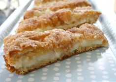 Sopapilla Cheesecake - Spread 1 can crescent rolls on bottom of pan. Combine 2 pks. of softened cream cheese, 1 cup sugar, 1 tsp. vanilla. Spread mixture over crescent rolls. Unroll and spread another can of crescent rolls over mixture. Spread 1/4 cup melted butter over top, sprinkle with cinnamon and sugar. Bake at 350° for 20-30 minutes.