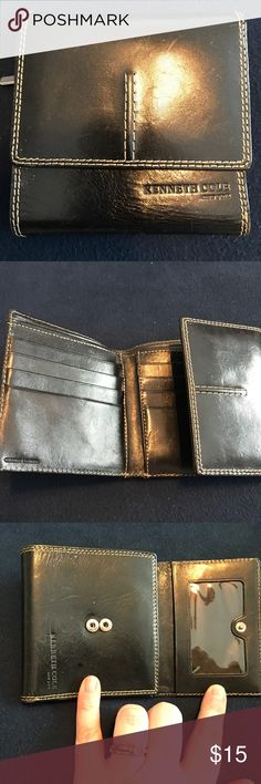Kenneth Cole Wallet This wallet is in excellent condition. Nice size with ID card window, 8 credit card slots, interior pockets, a divided cash slot and a zipper exterior pocket for change. Kenneth Cole Bags Wallets