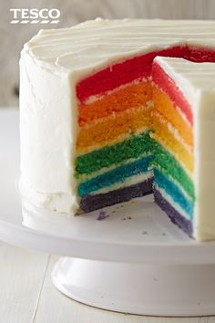 Celebrate Pride with the whole colour spectrum - this six-tiered rainbow cake recipe, with its whipped cream cheese icing, is a guaranteed showstopper. | Tesco