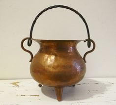 Vintage copper kettle or cauldron, hammered copper with a twisted iron handle, 1940s. $45.00, via Etsy.