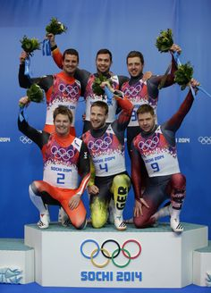 Gold medallists Tobias Wendl (centre top) and Tobias Arlt (centre bottom) of Germany celebrate during the flower ceremony with silver medallists Andreas Linger (top left) and Wolfgang Linger (bottom left) of Austria and bronze medallists Andris Sics and Juris Sics of Latvia after the Men's Luge Doubles (c) Getty Images Olympic Sports, Olympic Games, Olympic Winners, Bobsleigh, Luge, Winter Games, Winter Olympics, Winter Sports, The Man