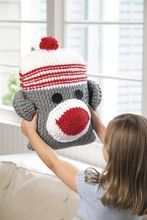 Loom knit sock monkey.  Pinning it to crochet board because I don't have a loom knit board (yet).