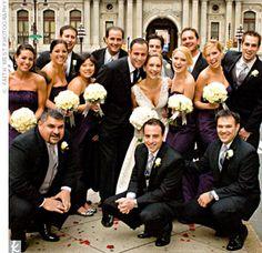 bridesmaids in plum, groomsmen in black tuxes with gray vests and ties