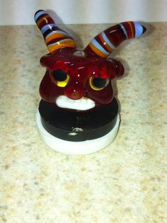 $20 red horned devil, 104 glass focal bead Various Artists, Devil, Sculptures, Birthday Cake, Beads, Desserts, Food, Birthday Cakes, Bead