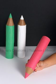 Another simple toy — gigantic pencils made out of toilet paper tubes.