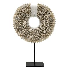 Perfect as a decorative object! The HK-Living Papua ornament is fully made of shells and has a metal frame. How do you combine this ornament?
