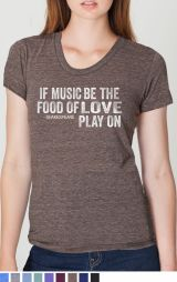 """This t shirt has the words –if music be the food of love, play on --- Shalespeare"""" written on the front. It is in white ink."""