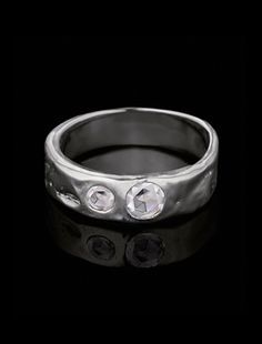 """""""Together"""" is a heavy, hand-textured platinum ring about 6mm wide, with 2 inset colorless rose-cut round diamonds, 0.11 and 0.23 carat each. Stunning as a wedding band or an alternative to a traditional engagement ring."""