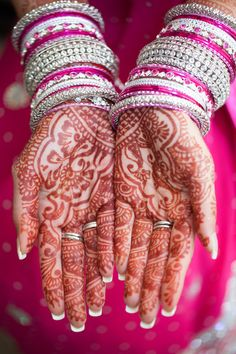 Before a hindu wedding the paint the brides hands with beautiful designs