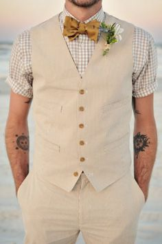 I like the style for a wedding that is bound to be warm.  Wear a jacket but under have a vest and short sleeved shirt.  Prepare for the jacket coming off.