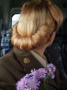 Vintage style hair 1940s back roll. I have always loved this look...maybe I should try it.                                                                                                                                                     More