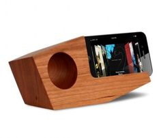 Handmade walnut wooden iPhone speaker by Koostik. This unique dock passively amplifies the volume of your Apple device in both portrait and landscape. A green Apple iPhone accessory!