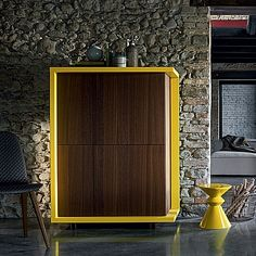 Flamboyant yellow and dark wooden 'Ryan' sideboard. Bright colour over dark. High quality wood. My Italian Living.
