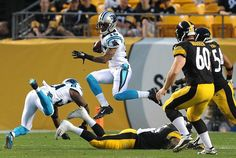 Carolina Panthers wide receiver Damiere Byrd, center, leaps into the air in hopes of eluding the Pittsburgh Steelers defense on a return during first quarter action on Thursday, September 3, 2015 at Heinz Field in Pittsburgh, PA.