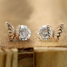 How nice Exquisite Elegant Winky Zircon Hollow Golden Butterfly Earrings ! I like it ! I want to get it ASAP!