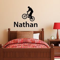 """Bike Decal with Boys Name - Personalized Wall Decal - Custom Boy Wall Art. The Bike & Boys Name Wall Decal is available in the color of your choice. See the color chart for your options. The photographs are for a reference be sure to use the measurements when ordering. Overall Size - 42.3"""" wide by 37.5"""" high (as arranged in the picture) Name - 42.3"""" wide by 10"""" high (size will vary depending on name) Biker - 23"""" wide by 27.1"""" high ** Please type the name in the message box while checking..."""