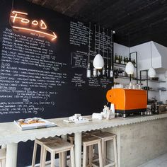 Rawduck, while not being repellently fancy, has stepped things up a notch with its fresh, clean and simple interior.  operating as a wine shop as well as an all-day eatery...  Neon sign❤️