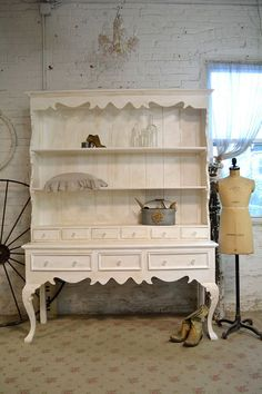 Wow! What a great farmhouse cabinet!    FEATURES:French country design with lots of drawers and shelf space.    FINISH: Painted with our cottage