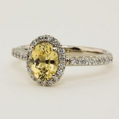 Fancy Diamond Halo Ring with 8x6mm Oval Yellow Sri Lanka Sapphire