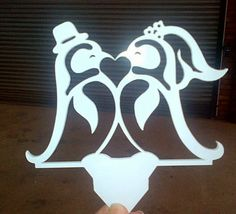 Laser cut penguins cake topper