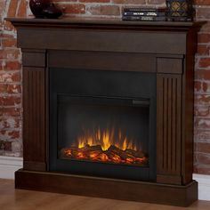 Features: -Made of solid wood and veneered MDF. -Firebox has 1400W heater, rated over 4,700 BTUs per hour. -Fireplace must be anchored to a wall for safety reasons. -Fully electric: Yes. -Not rec More