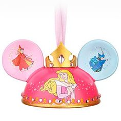 Disney Sleeping Beauty Ear Hat Ornament   Disney StoreSleeping Beauty Ear Hat Ornament - Hail to the Princess Aurora and her limited edition ear hat ornament gifted with pretty pink gems and adorned with her signature royal crown. Overhead, the classic fairy battle of ''pink or blue'' leaves a tell-tale mark between the ears.