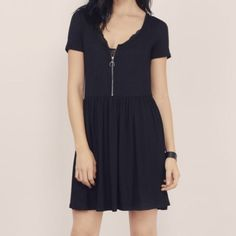 Tobi T-shirt dress A cute, casual, BabyDoll doll T-shirt dress with zipper detail in front. Never worn! Brand new with tags still on! Tobi Dresses