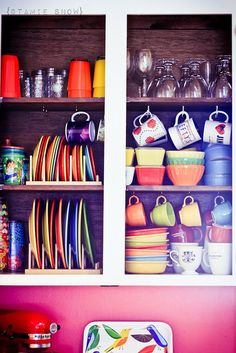 love coffee mug hooks- @Holli Downs Howard, we need some of these so all our stuff will fit in the cabinets!