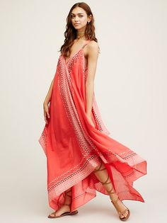 Merida Printed Maxi | Beautifully printed maxi dress featuring beaded embellishment and flowing, shapeless silhouette. V-neckline and keyhole cutout at the back. Slit at the front hem and an overall relaxed fit. Lined.