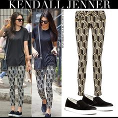 Kendall Jenner in black top with geometric print jeans and black slip on sneakers