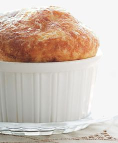 The Loftiest Soufflé - 3 tablespoons unsalted butter plus more, room temperature, for ramekins  4 tablespoons finely grated Parmesan, divided  3 tablespoons all-purpose flour  1 cup cold whole milk  1 cup grated Gruyère, divided  Pinch of freshly grated nutmeg  Kosher salt, freshly ground pepper  4 large eggs, yolks and whites separated  1/4 teaspoon xanthan gum (optional)